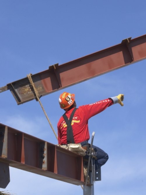 steel ibeams being placed by iron worker.jpg
