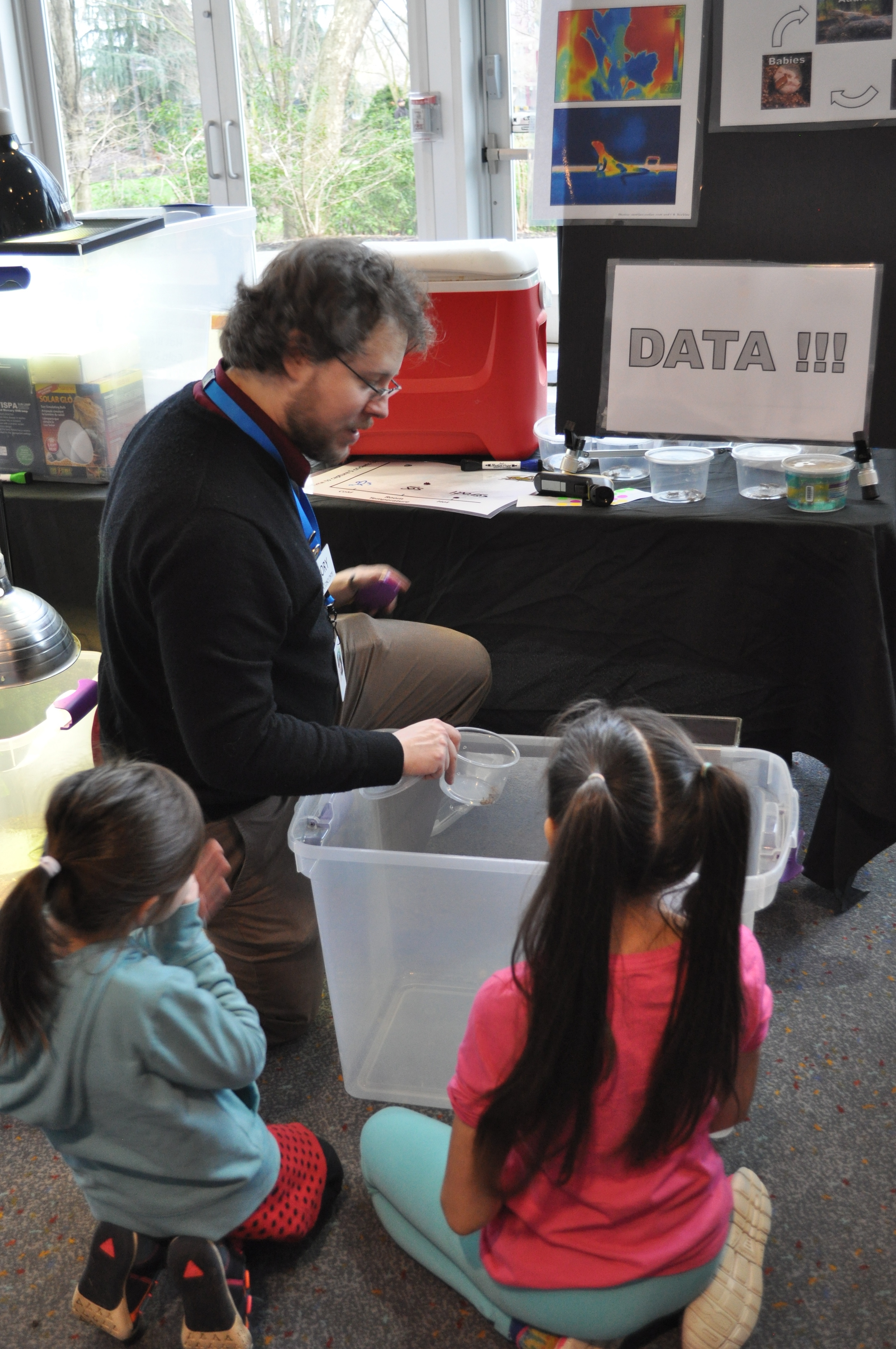 """Rory presenting at """"Meet a Scientist"""" at the Pacific Science Center. These young guests were conducting an experiment to determine the thermal preference of crickets!"""