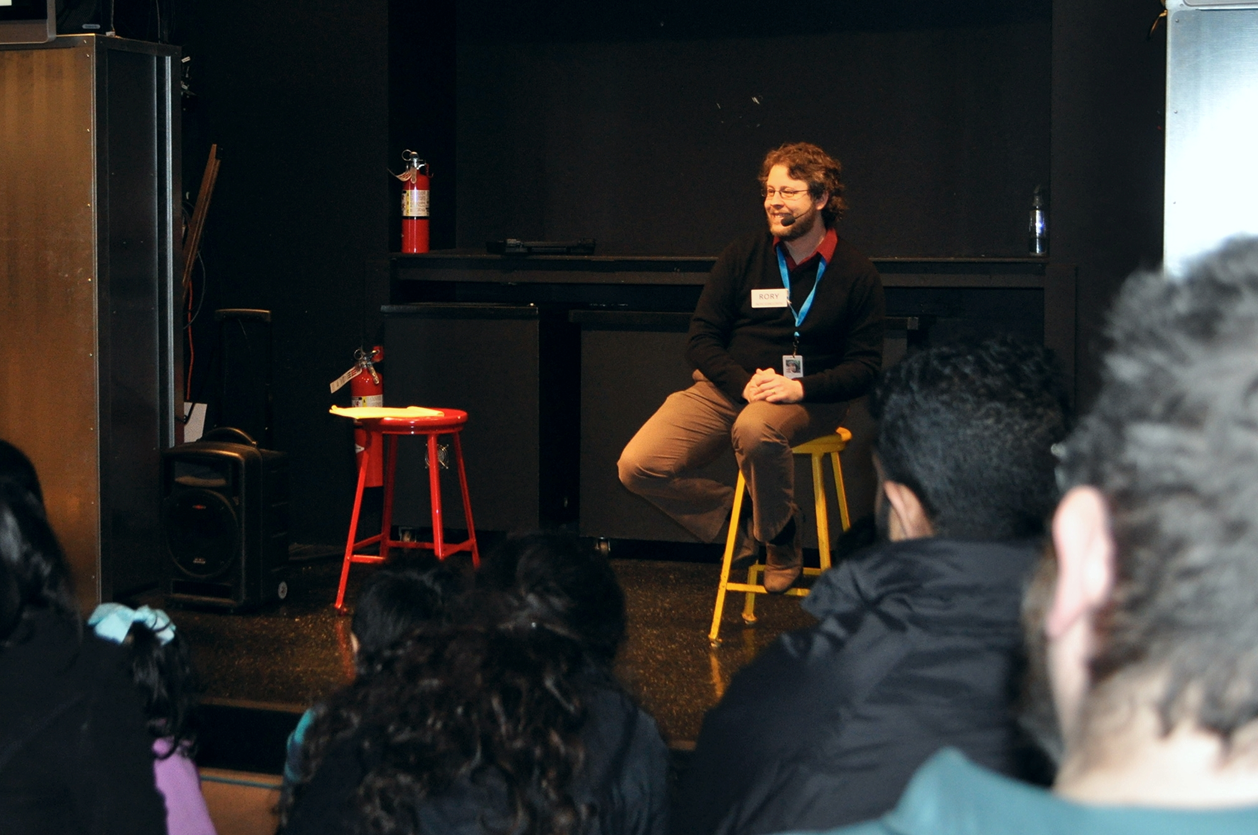 """Rory presenting at """"Scientist on a Stage!"""" at Pacific Science Center."""