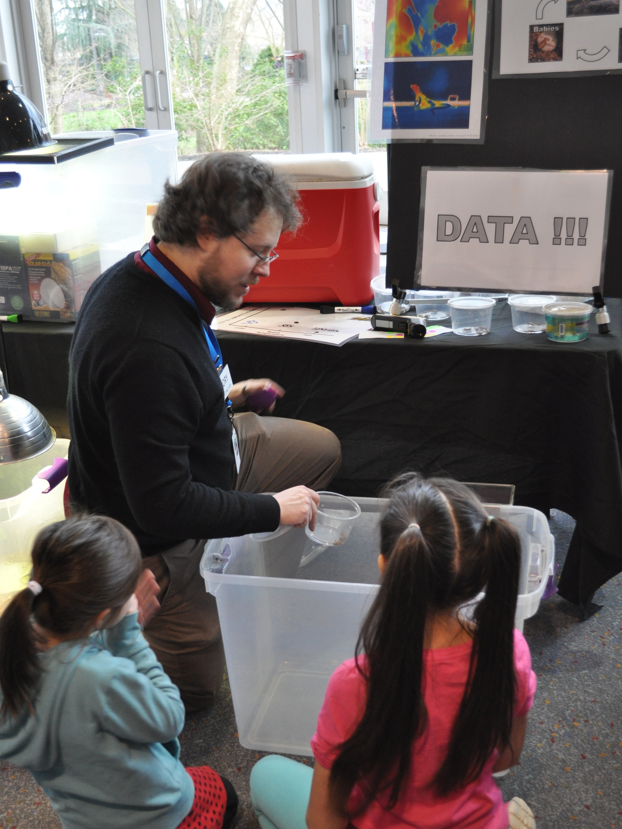 "Rory presenting at ""Meet a Scientist"" at the Pacific Science Center.  These young guests were conducting an experiment to determine the thermal preference of crickets!"