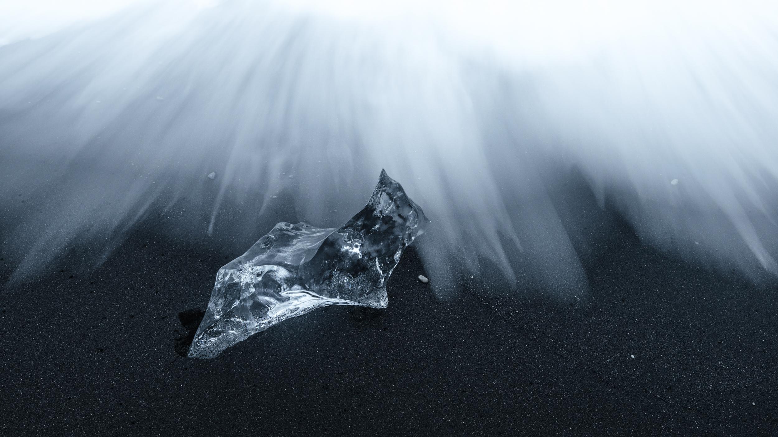 A small chunk of ice on the black sand beach of Jökulsárlón, Iceland.