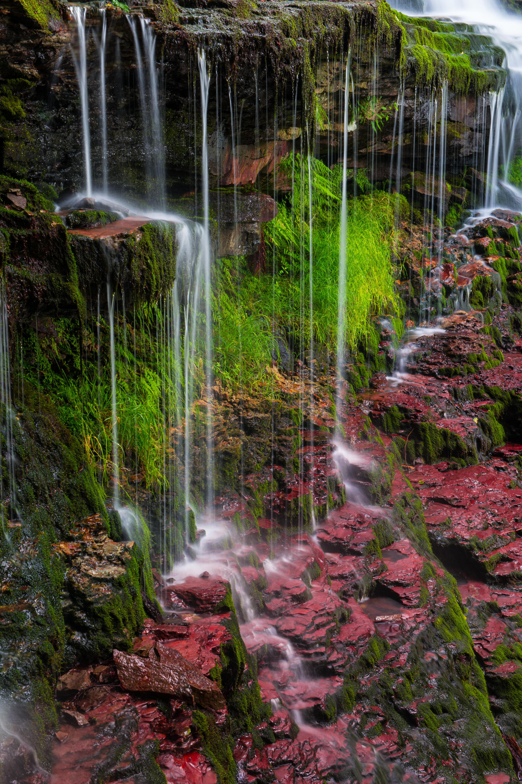 Small strings of water fall in Ricketts Glen State Park. Benton, Pennsylvania.