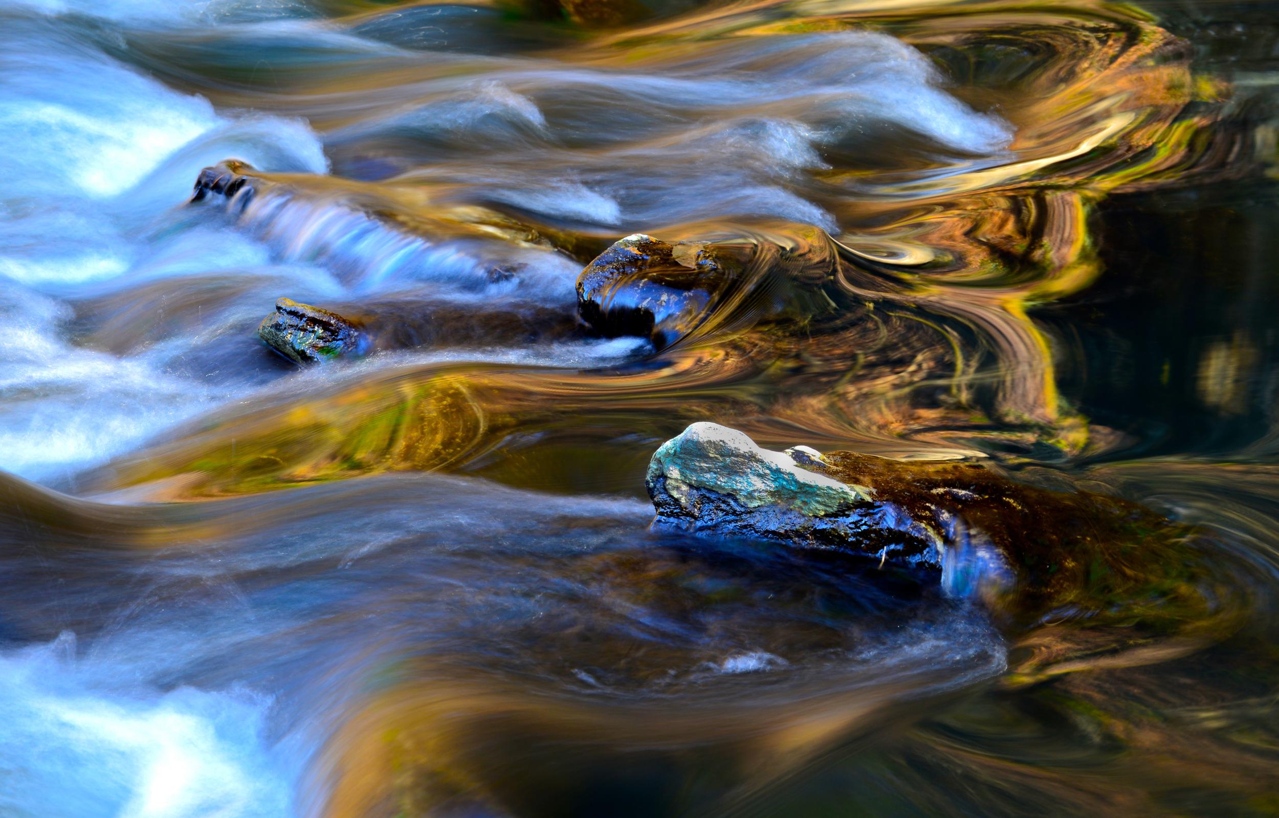 Water bends around the rocks in Wissahickon creek, Philadelphia.