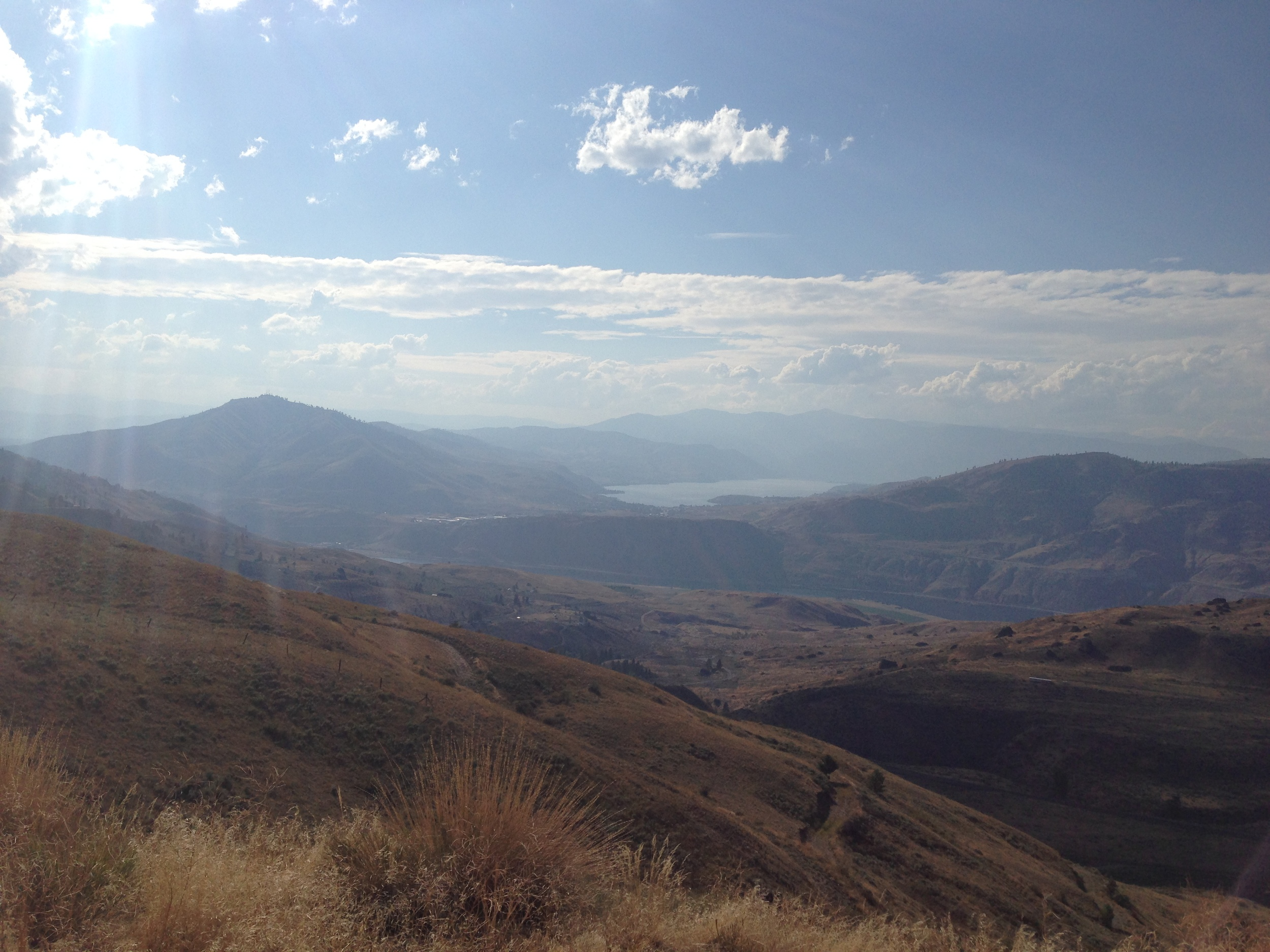 McNeil Canyon leading down to the Columbia River (not really visible) andLake Chelan in the distance.