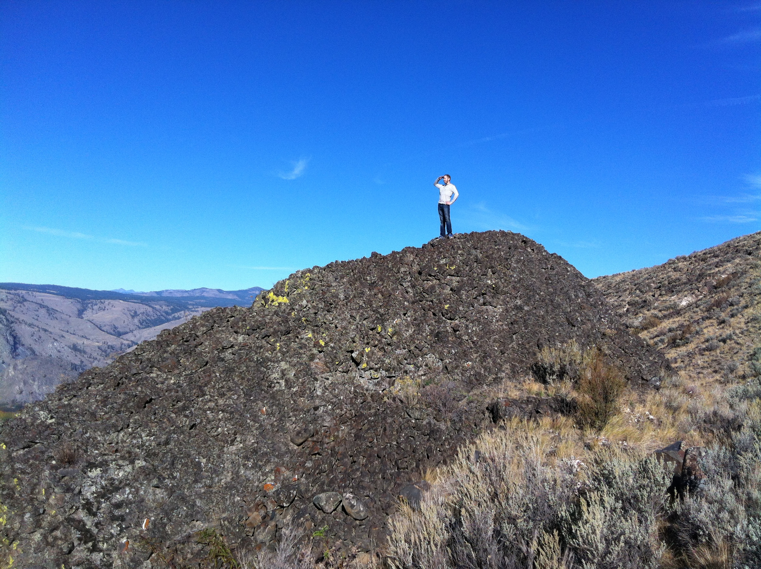 This basalt monolith anchors the Northwest corner of our land and looks to be about half its actual size from the end of the driveway up above. The hillside is so steep we had to zig-zag constantly to avoid slipping and sliding down.