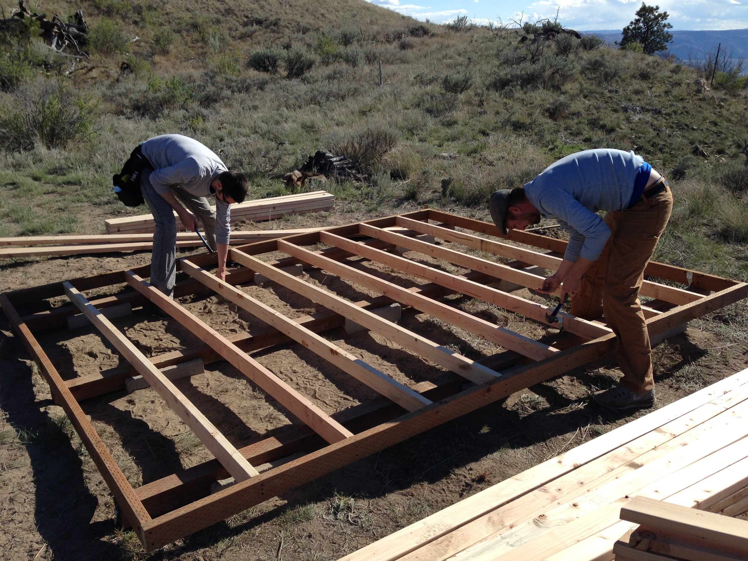 Joists being tied into the skids with metal rafter ties.