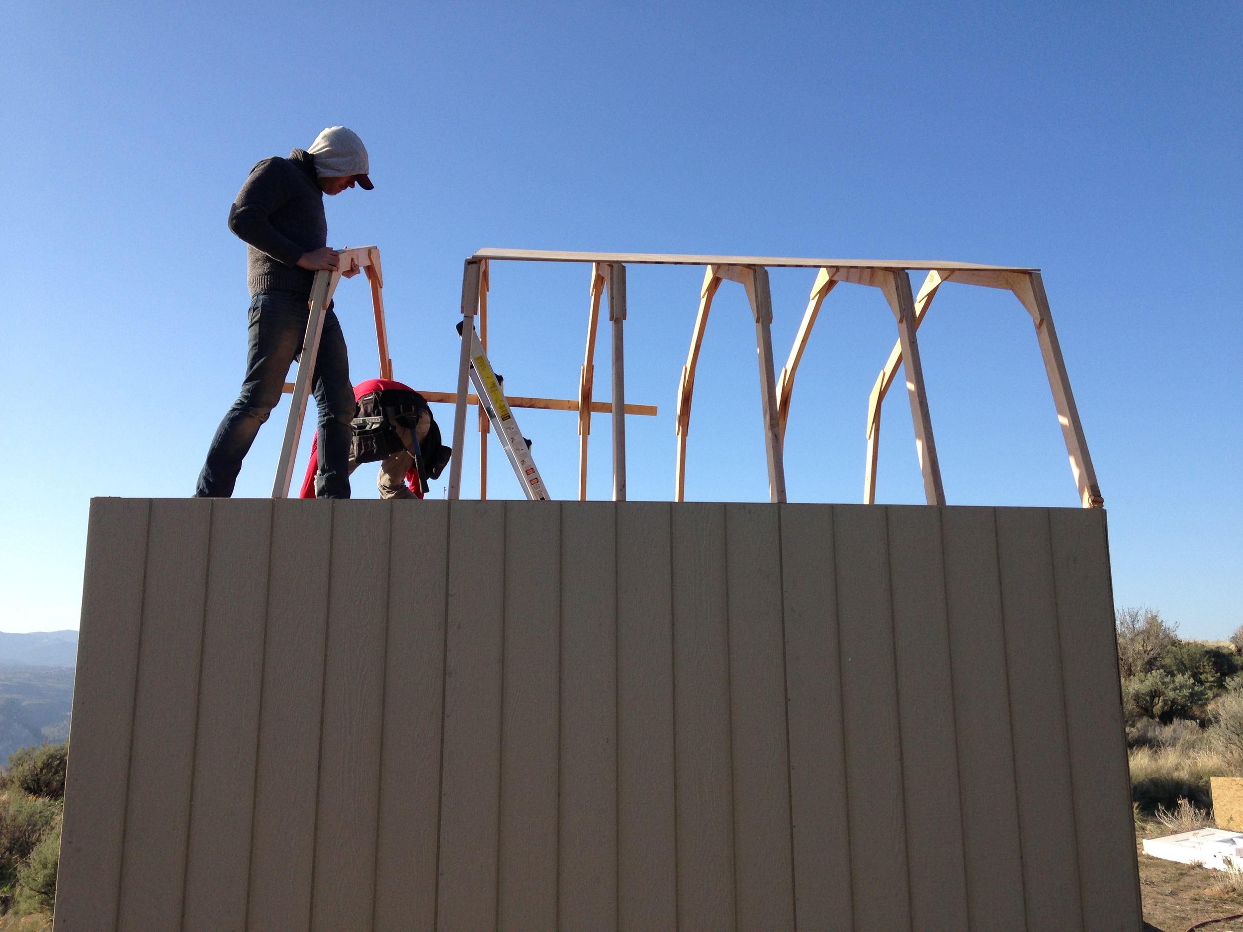 Adding the trusses over the loft was much easier with solid ground to stand on.
