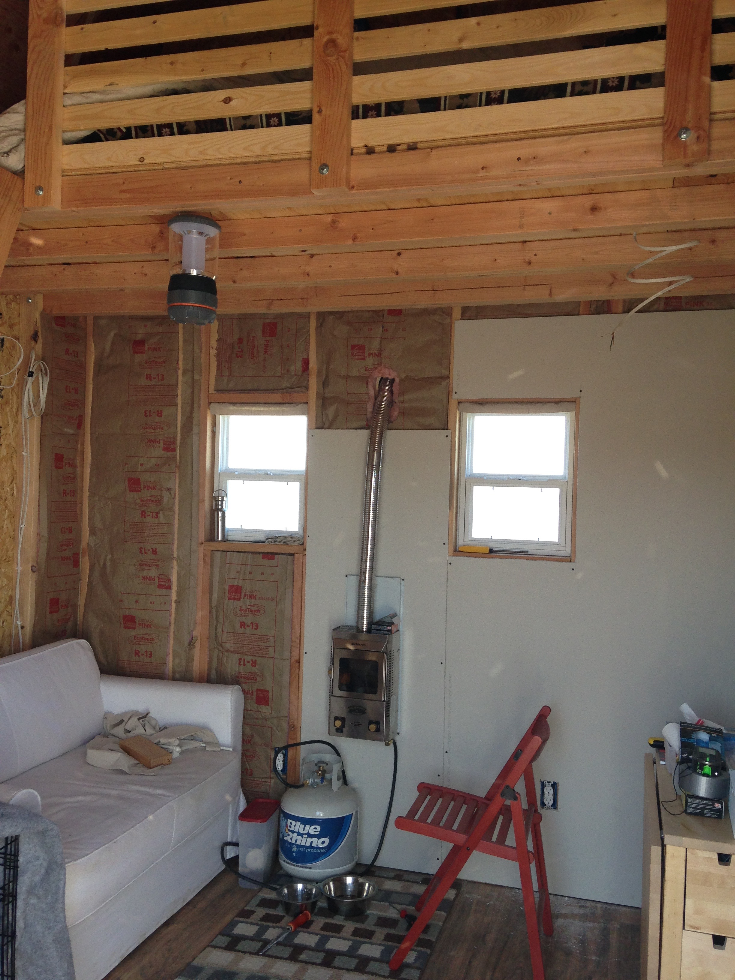 Insulation in place with a few drywall panels installed.