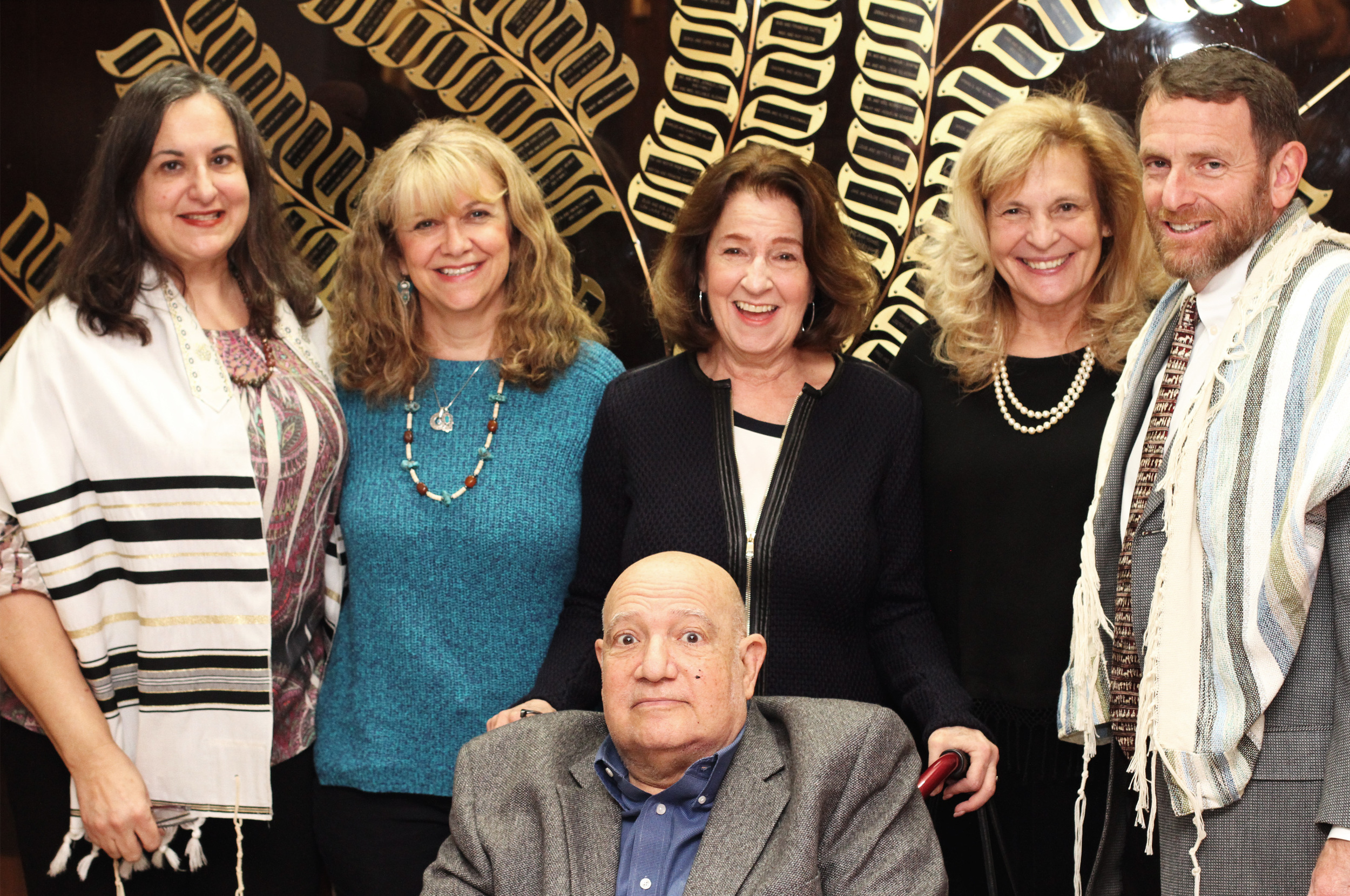 Temple Emanu-El Staff pose for a picture for Olga and Bob Strauss