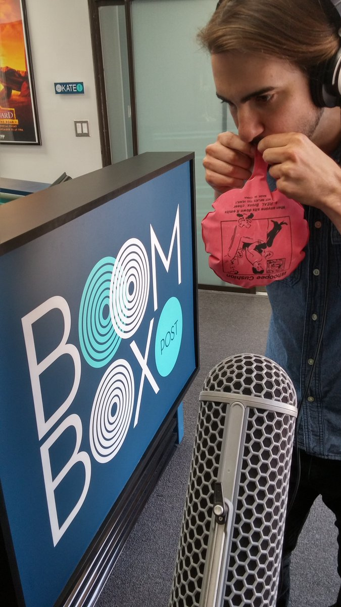 Our newest intern, Evan, helps to record inflating whoopee cushion sounds.