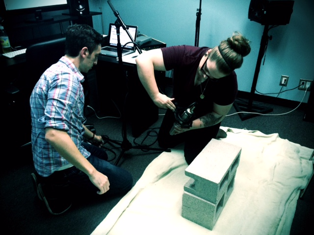 Jessey and Jeff prep to record cinder block scrapes as a key sonic element in skeleton warrior coming to life.