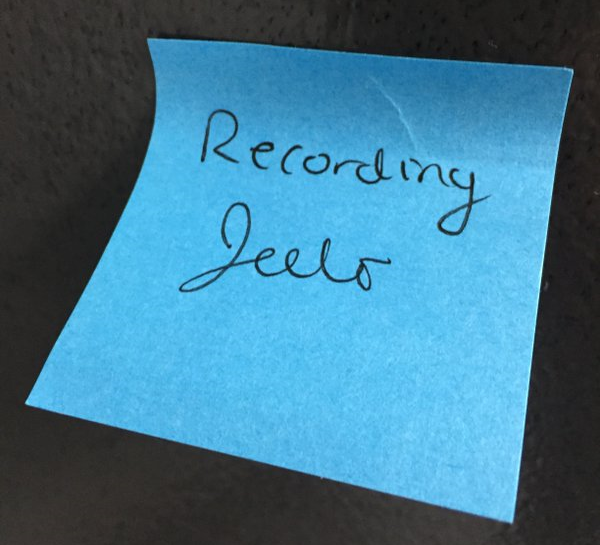 A Post-It on the door from that time Olivia recorded herself mucking around in a bucket of Jell-O in the dark (because the light turned on the fan!) to get just the right squish sound effect.