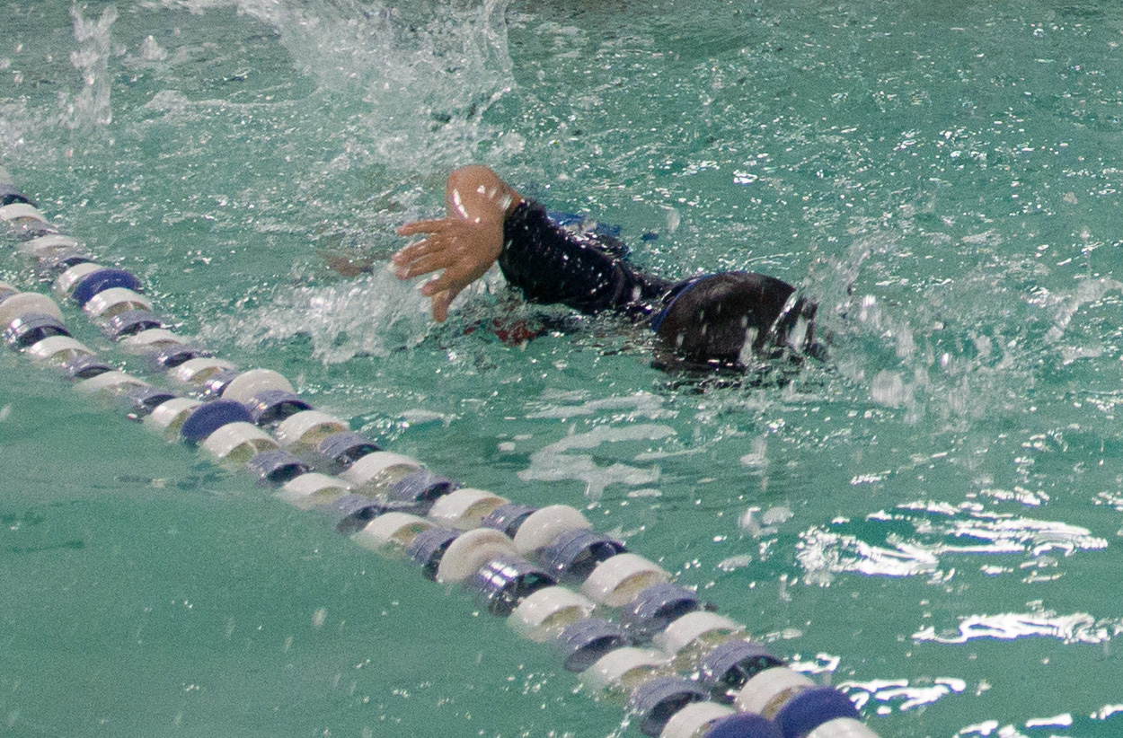 Did a terrific job locking focus on a moving subject indoors (granted my son is not a fast swimmer but you get the gist).