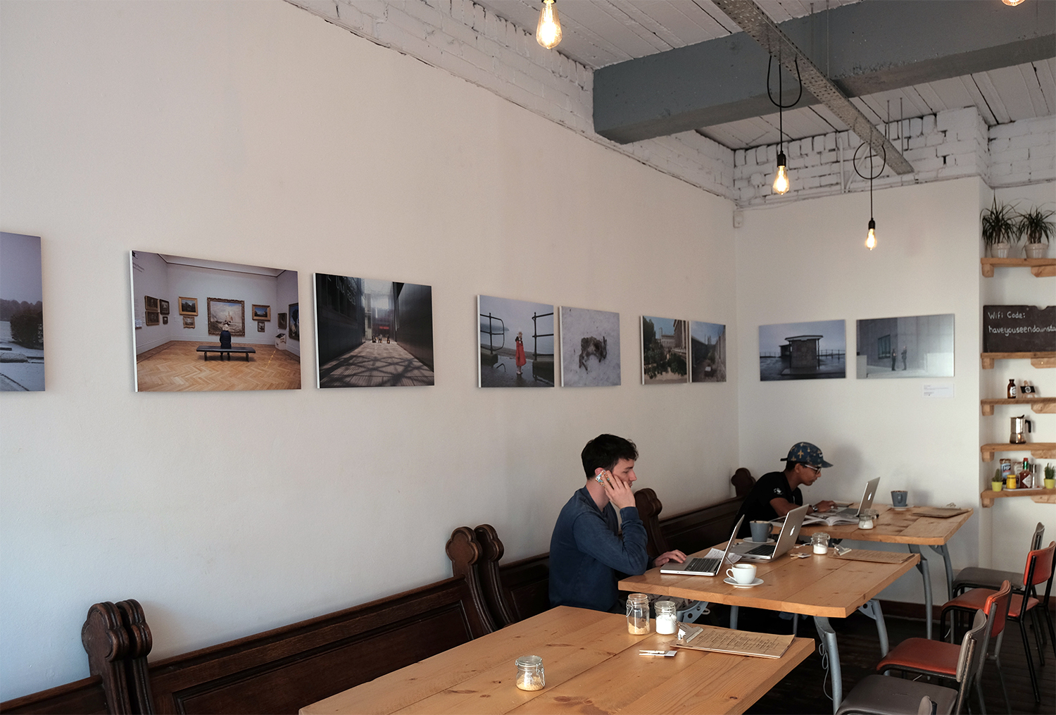 Work by Eleri Griffiths on the walls at Littleman Coffee in Cardiff
