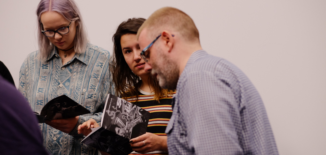 Marc Vallée showing his self-published Zines to photojournalism students at the University of South Wales