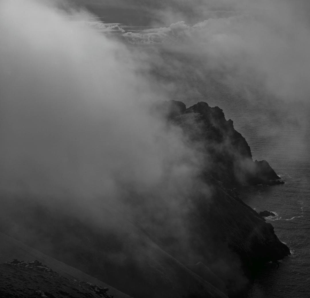 Dùn and Ruabhal in the mist. Cover image for Alex's new book ' St Kilda: The Silent Islands' © Alex Boyd
