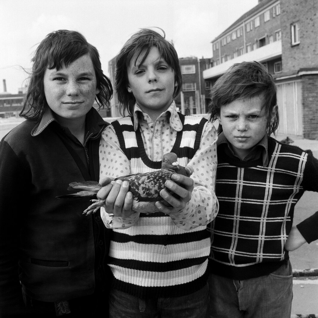 John Payne (centre) and friends, with pigeon Chequer. Portsmouth, April 1974 © Daniel Meadows