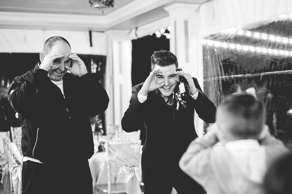 Daniel K. Photography takes photo of wedding guests making funny faces with the ring bearer at a wedding in Raleigh, North Carolina making funny faces with the ring bearer.
