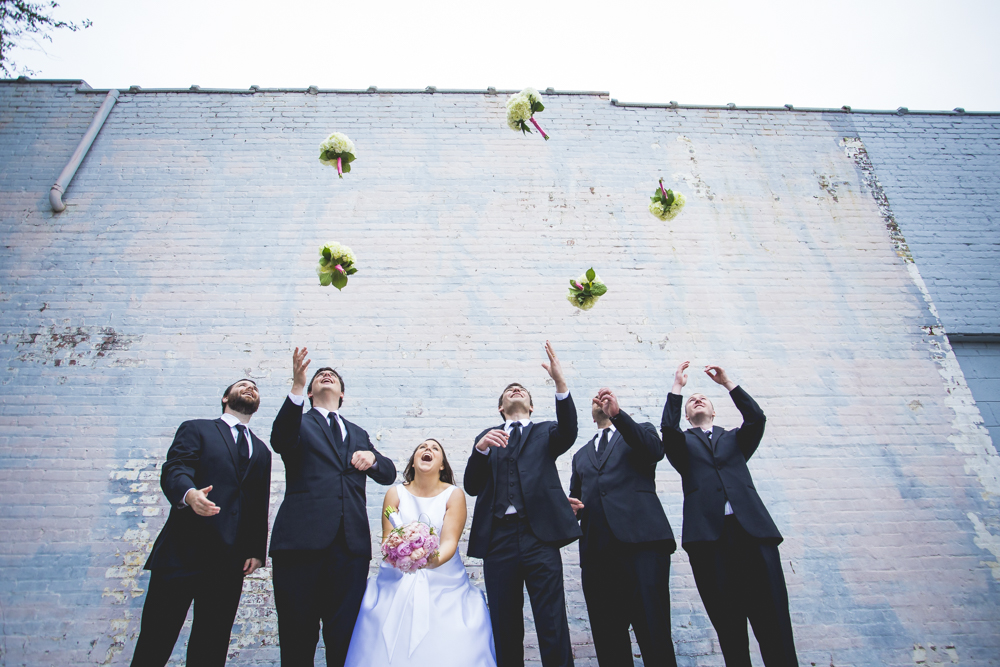 The groomsmen from Rachel & Eric's wedding stole the bouqet from the bridesmaids and proceeded to toss them up in the air.