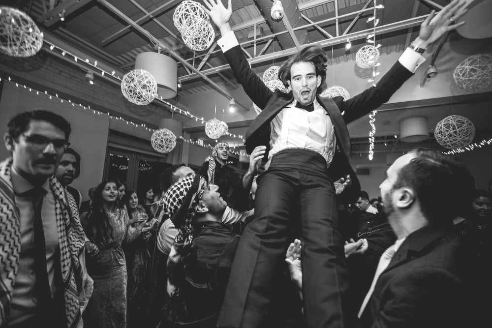 Groom gets tossed around at a ridiculously fun Palestinian wedding in Raleigh, North Carolina. Photo taken by Daniel K. Photography