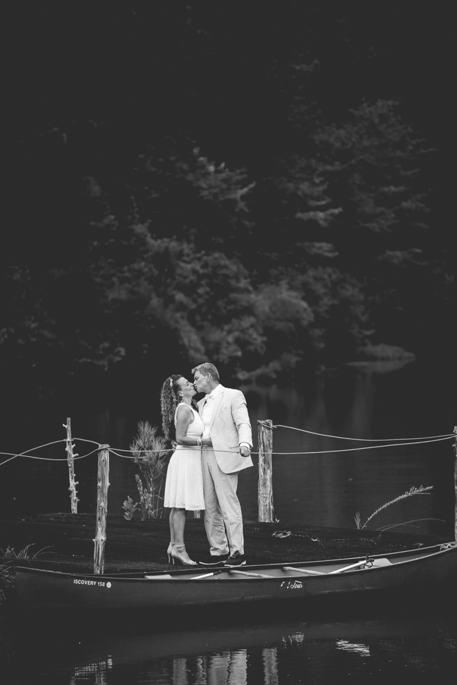 recently-married-couple-kiss-on-dock