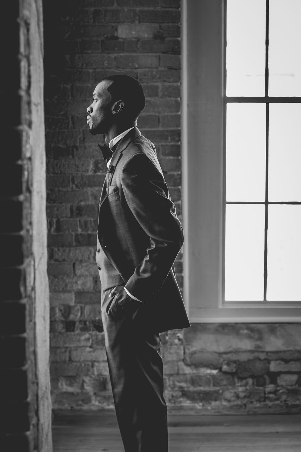 Groom looks onwards as he awaits his wedding day at The Cotton Room in Durham, North Carolina.