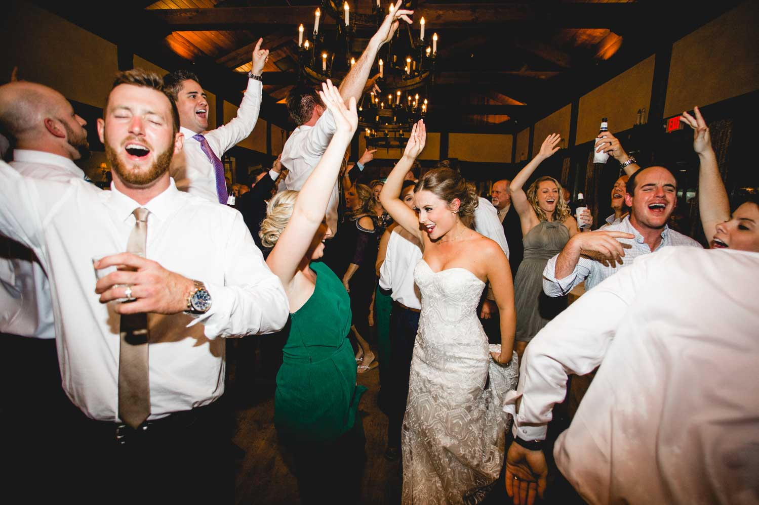 Wedding party having an absolutle blast dancing on the dance floor at Macgregor Downs Country Club wedding venue.
