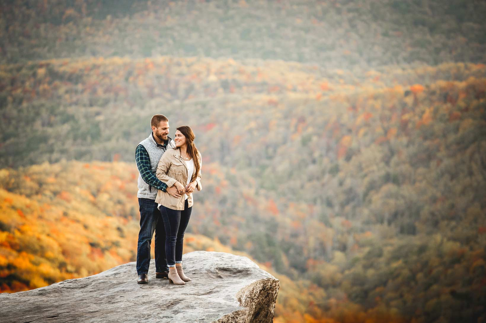 Engagement session photo taken on top of North Carolina's Rough Ridge located along side the Blue Ridge Parkway in Linville, NC