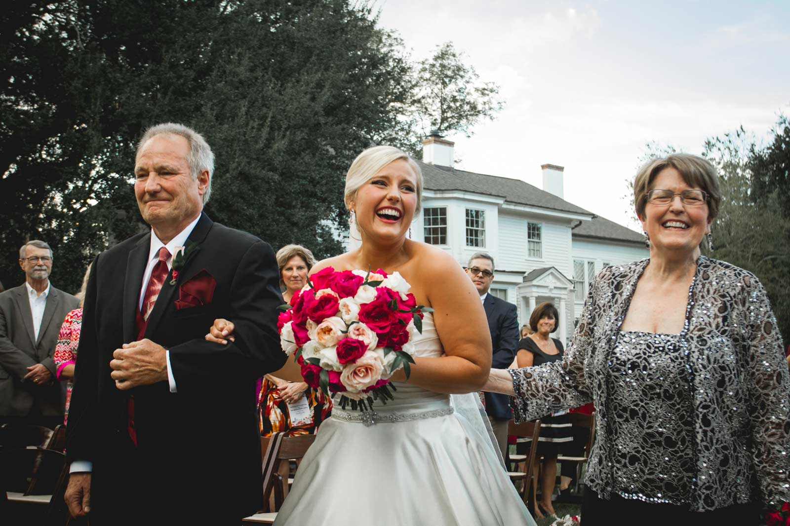 Beautiful bride walks down the aisle at the gorgeous Rye Patch wedding venue in Aiken, South Carolina