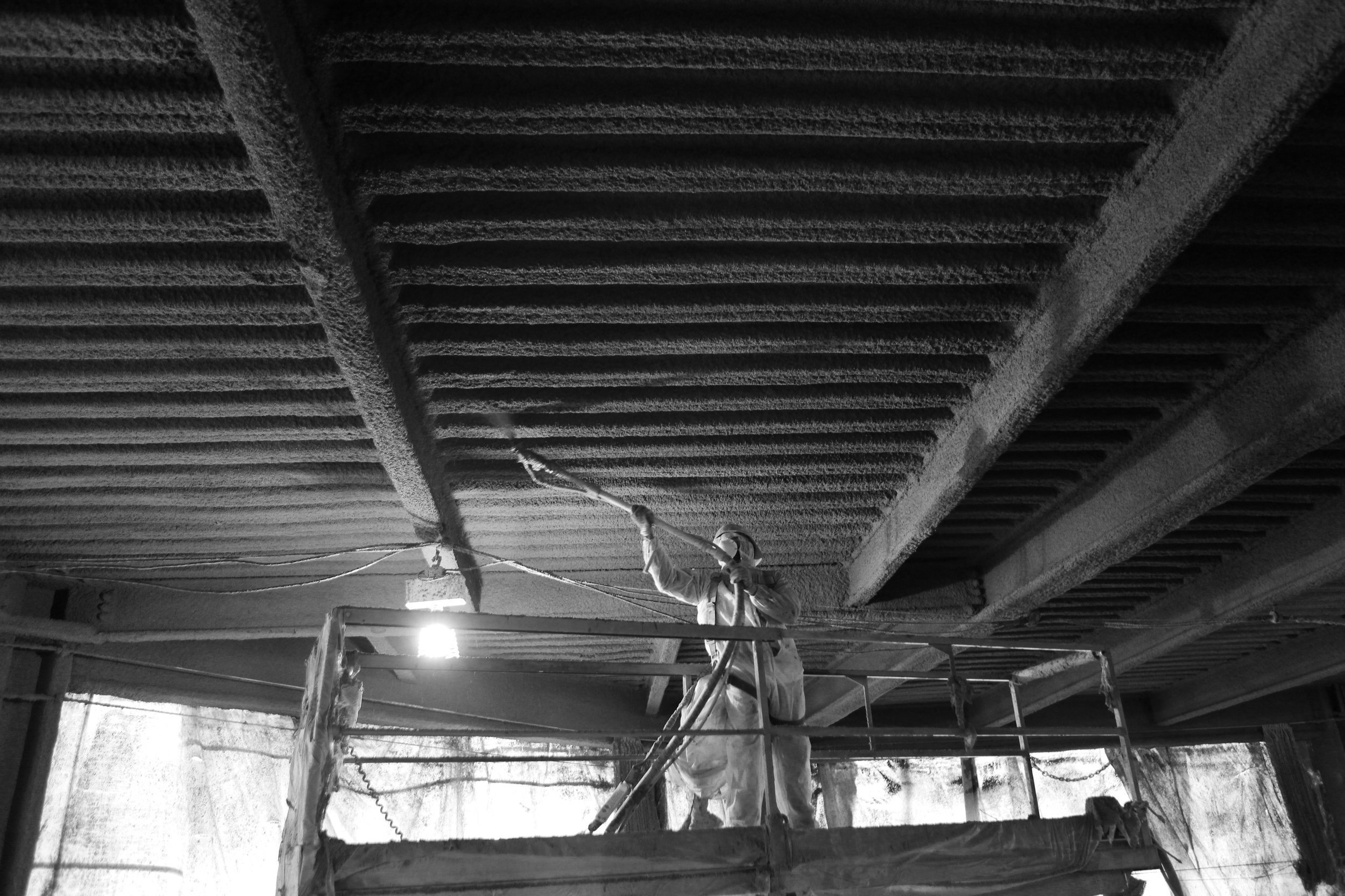 SPRAY ON FIREPROOFING - A passive fire protection measure; refers to the act of making structures resistant to fire. Applying a UL listed fireproofing system gives steel buildings the ability to maintain their structural integrity in a fire, ranging anywhere from 1 to 4 hours - giving the occupants valuable time to evacuate.
