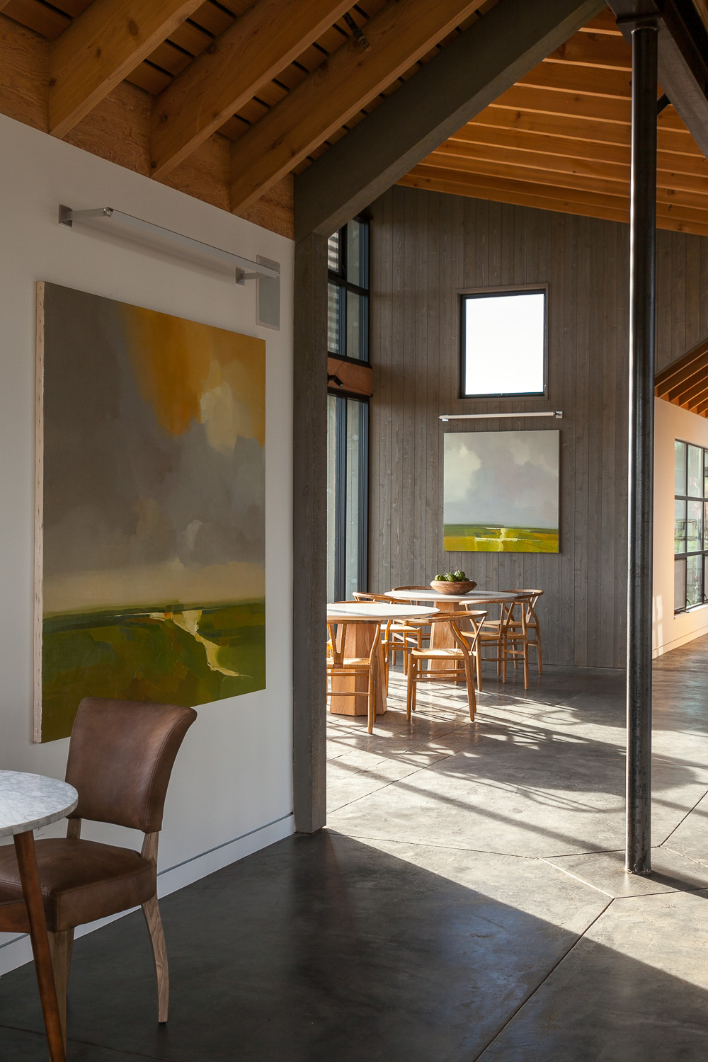 The artwork in the MacRostie Winery estate house tasting room appear almost to be additional windows.