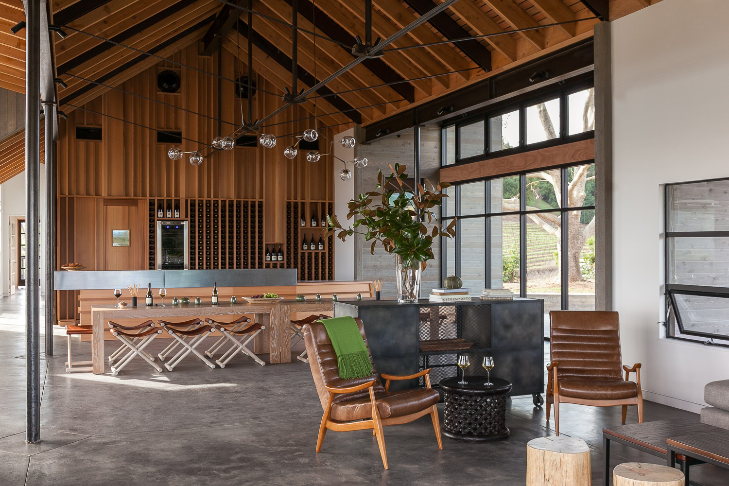 MacRostie Winery's estate house tasting room features high ceilings and a large expanse of windows letting in streaming sunlight.