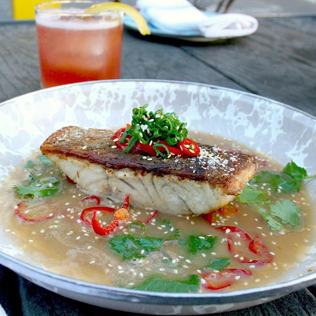 This fish is so delish. Favorite from the new menu. // Barramundi, herb mix, Fresno chili, sesame seeds, ginger citrus broth.