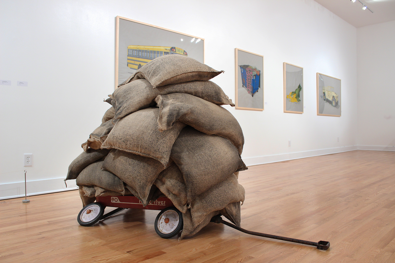 "Radio Flyer  , burlap sacks & found wagon, 2016, 50 x 62 x 36""."