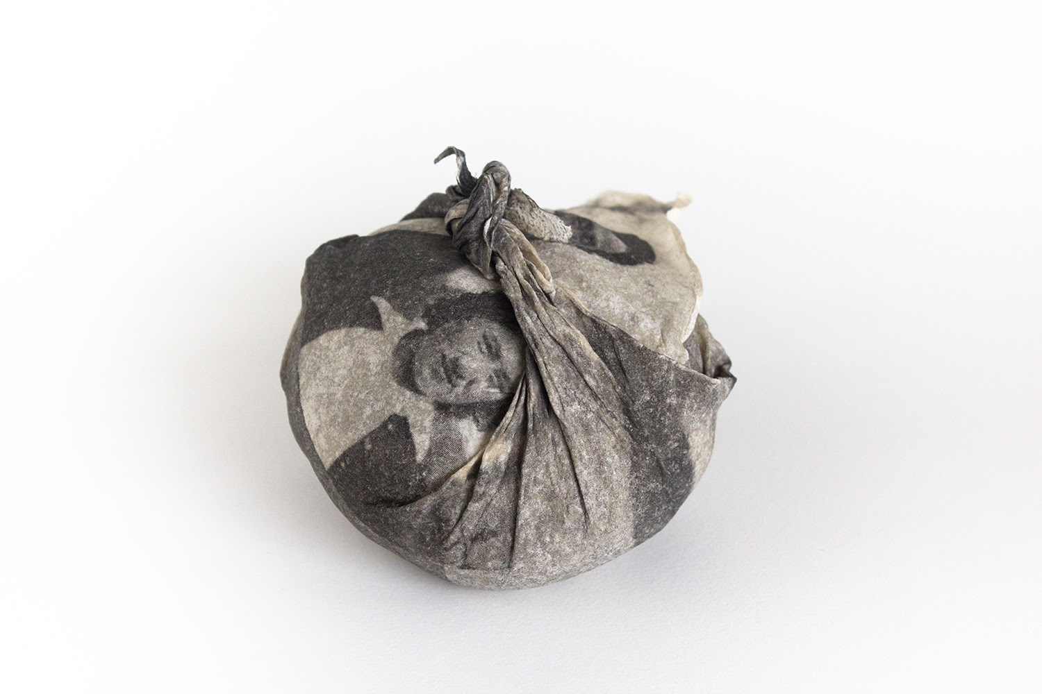 Emma Nishimura .  Mary and Kay, Vernon 1945  from  An Archive of Rememory , 2016–ongoing. One from a series of photoetching and photogravures on handmade flax and abaca paper. Each furoshiki approx. 3 × 3 × 2 ½ inches. Installation dimensions variable. Courtesy the artist. © 2019 the artist.