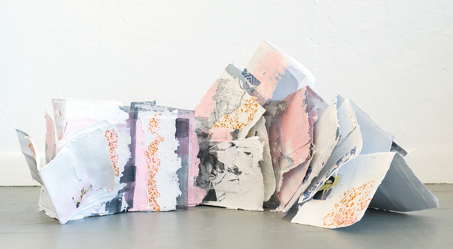 Tahir Carl Karmali .  PAPER:landscape , 2017. Handmade paper pulped from visa application documents, with transfer prints, xerox collage, aluminum mesh, and rust transfer. Installation dimensions variable. Courtesy the artist. © 2019 the artist.