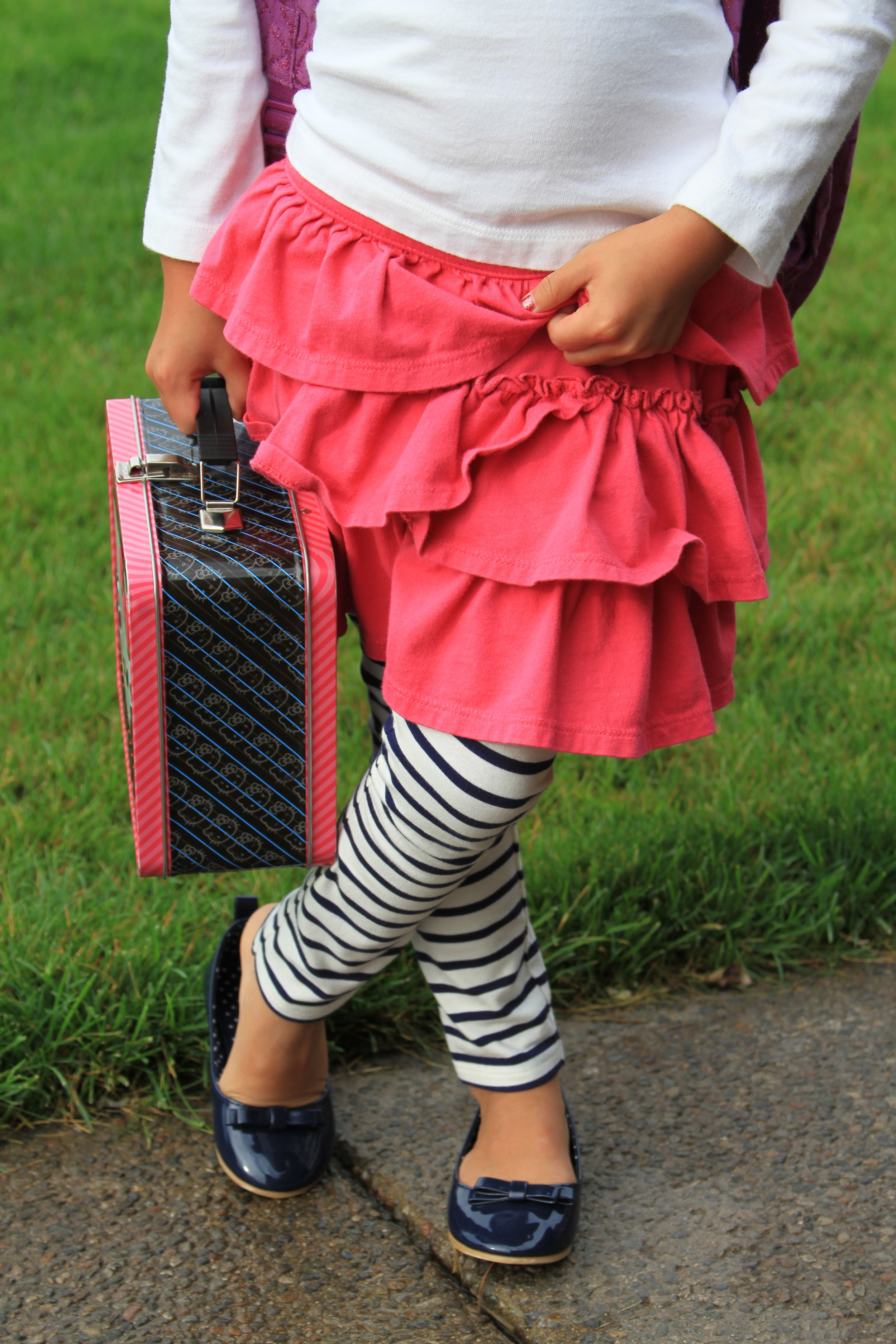 Photo Tip: You don't always need the whole kid; especially when you want to focus on other details, like new clothes, shoes and that adorable stance!