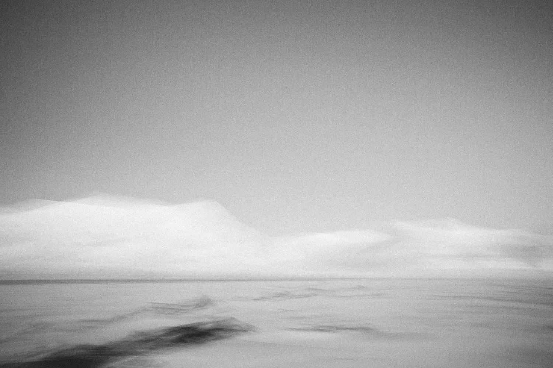 Winter mountains of Svalbard, Longyearbyen, Norway. Minimalistic arctic nature.