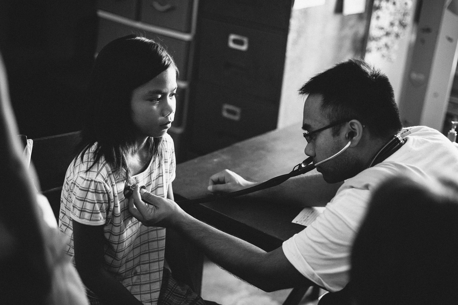 A young girl is having her lungs checked. Village of Dulag, Leyte Province, Philippines