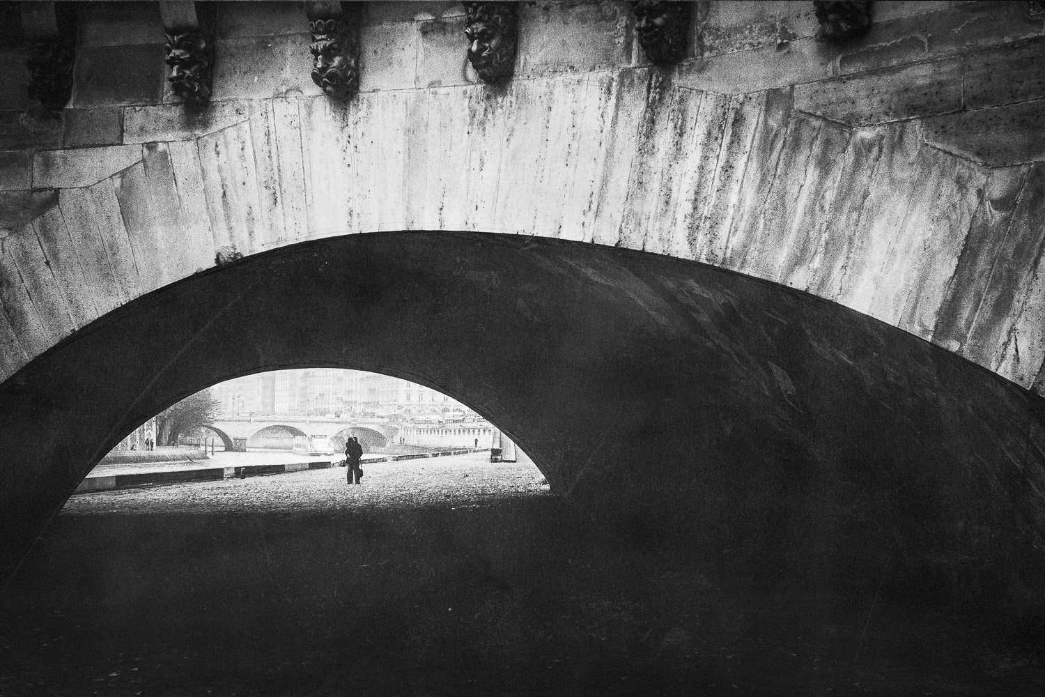 Lovers kiss under the bridges of Paris, France