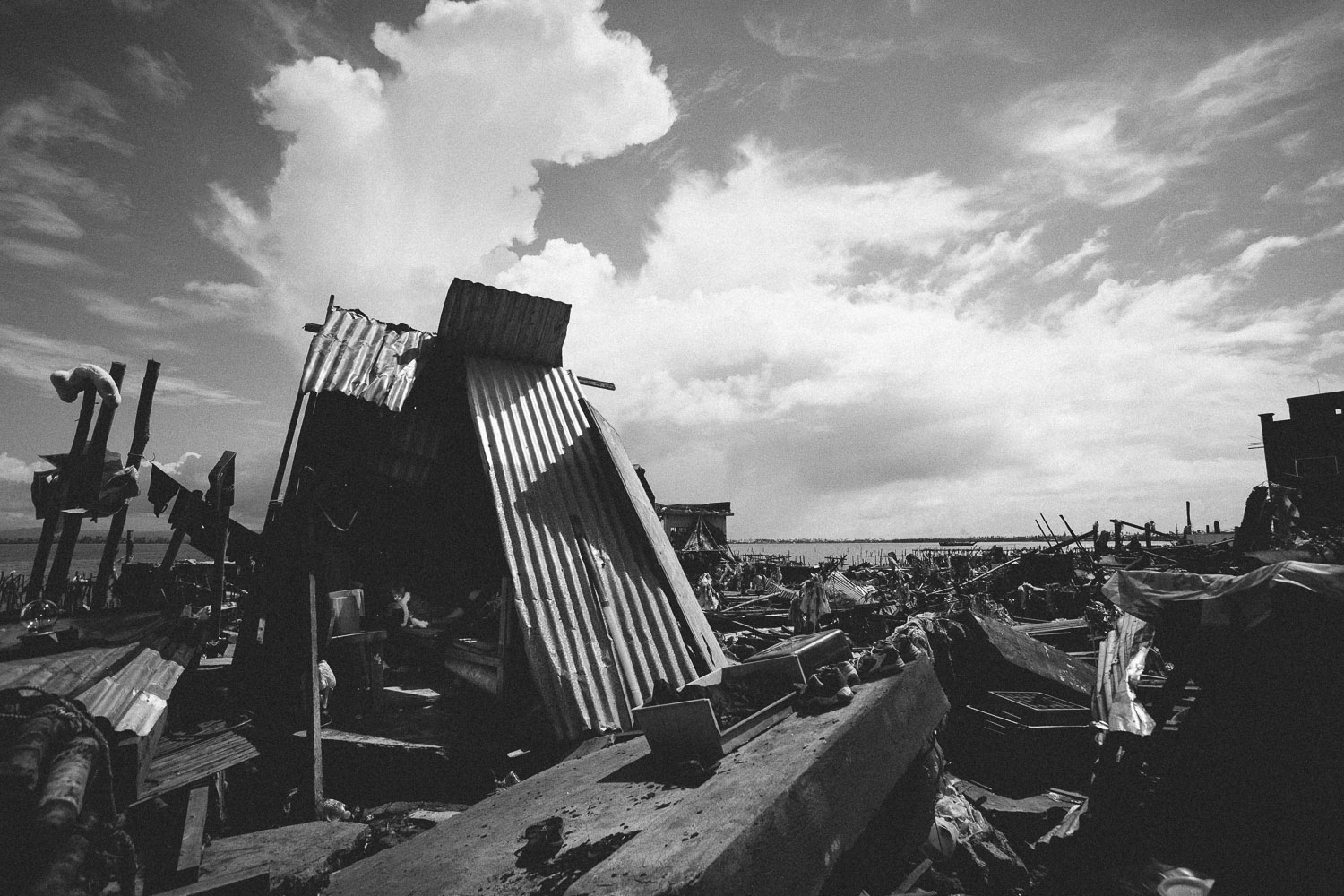 Tacloban City. While providing shade for the burning sun, the many makeshift shelters in the city provide little protection against daily rain bursts, let alone any further storms to come.