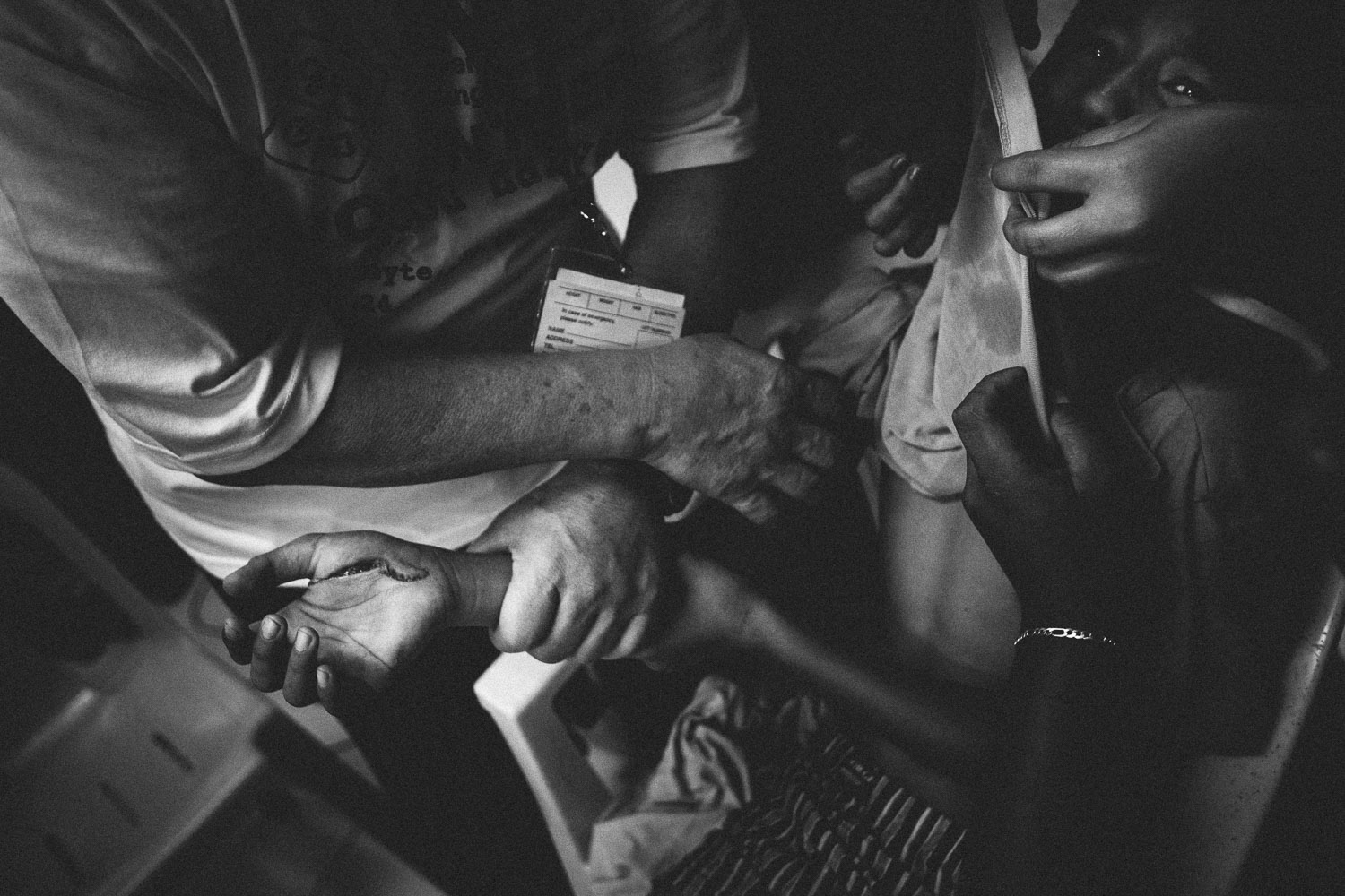 Village of Dulag. A boy is carried into the emergency room with a badly cut hand, where a team of American doctors stitch him up. By nothing short of a miracle he has avoided permanent damage to the critical nerves of the hand.