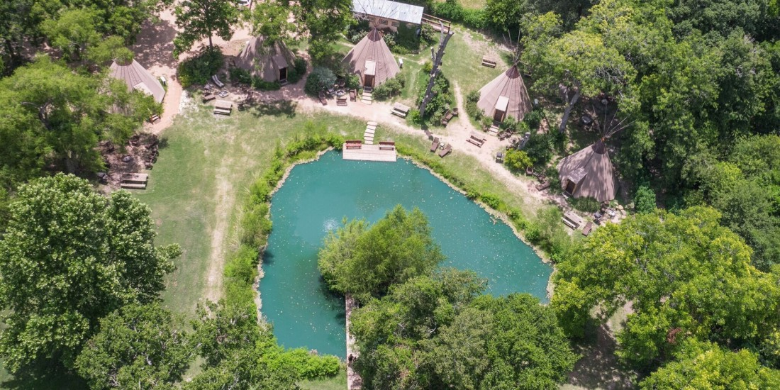 Areal-view-of-tipis-at-Geronimo-Creek-Retreat-1100x550.jpg