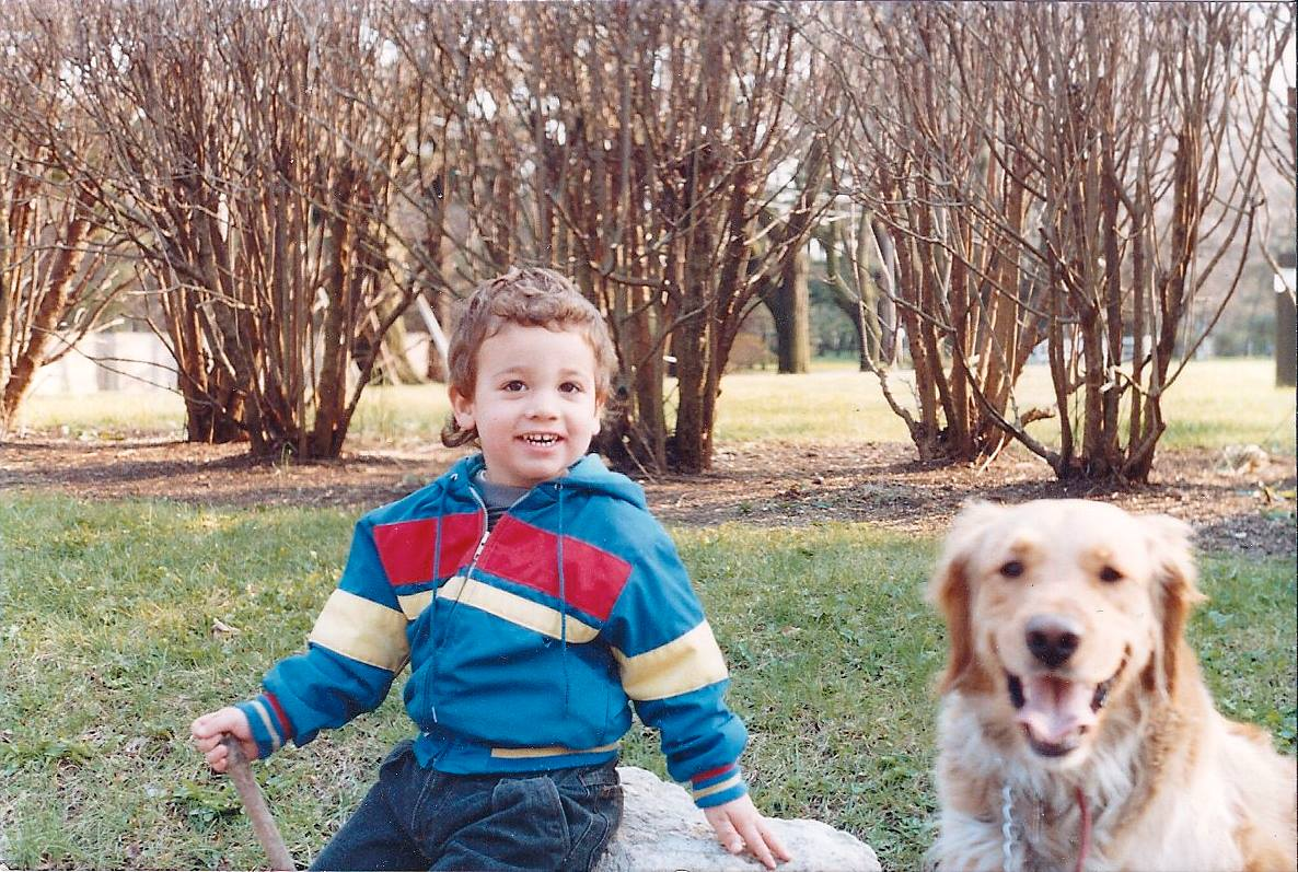 Dan at age 4 with his Golden Retriever, Sasha