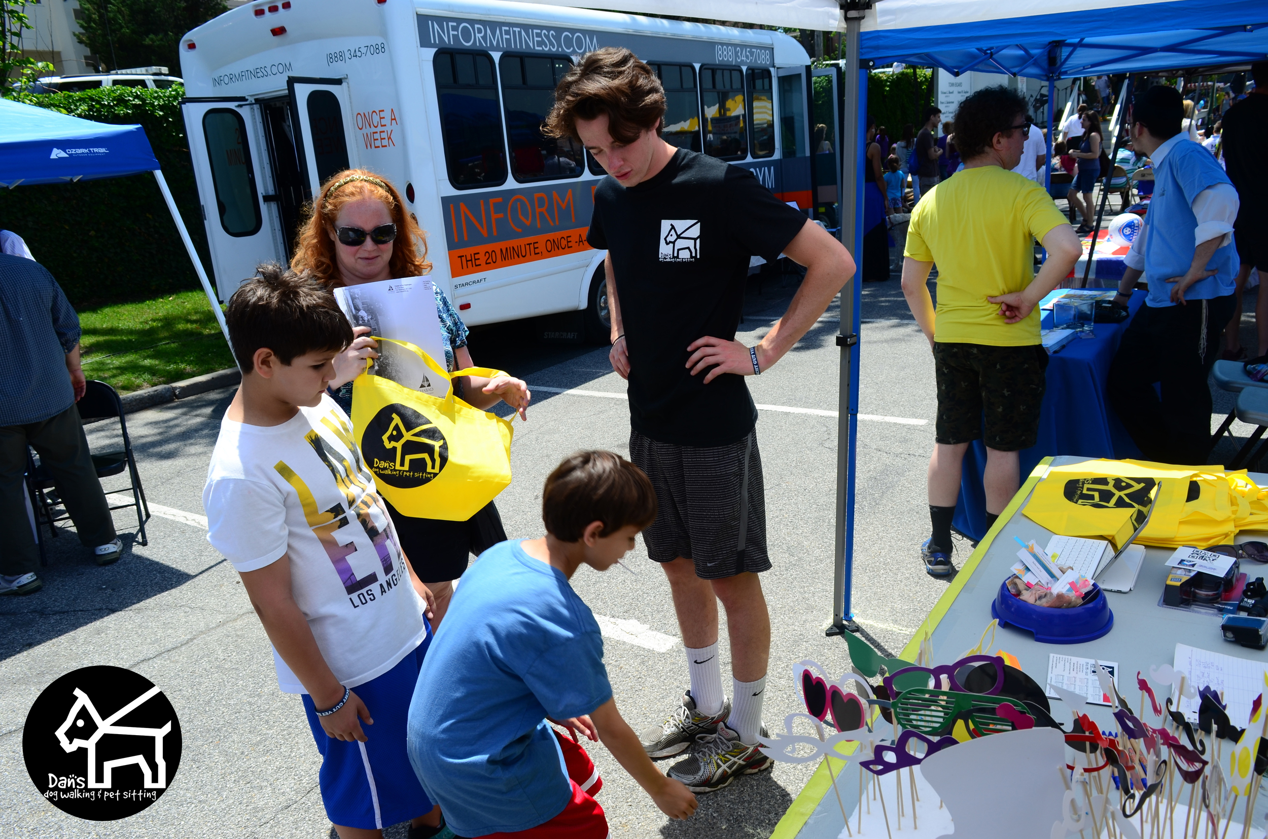 Dan talking about our services at Dan's Dog Walking and Pet Sitting Doggie Photo Booth at Harbor Fest 2015.jpg