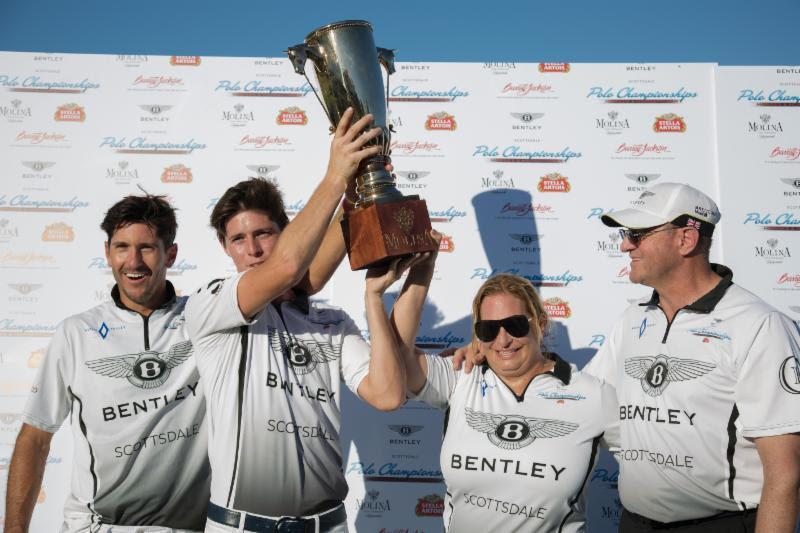 Aspen Valley Polo Club's Nic Roldan, Juancito Bollini and Melissa Ganzi hoist the Molina Cup.