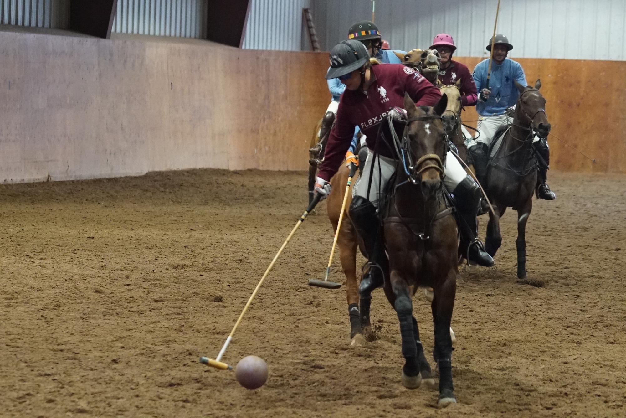 Melissa Ganzi of Flexjet steals the ball.JPG