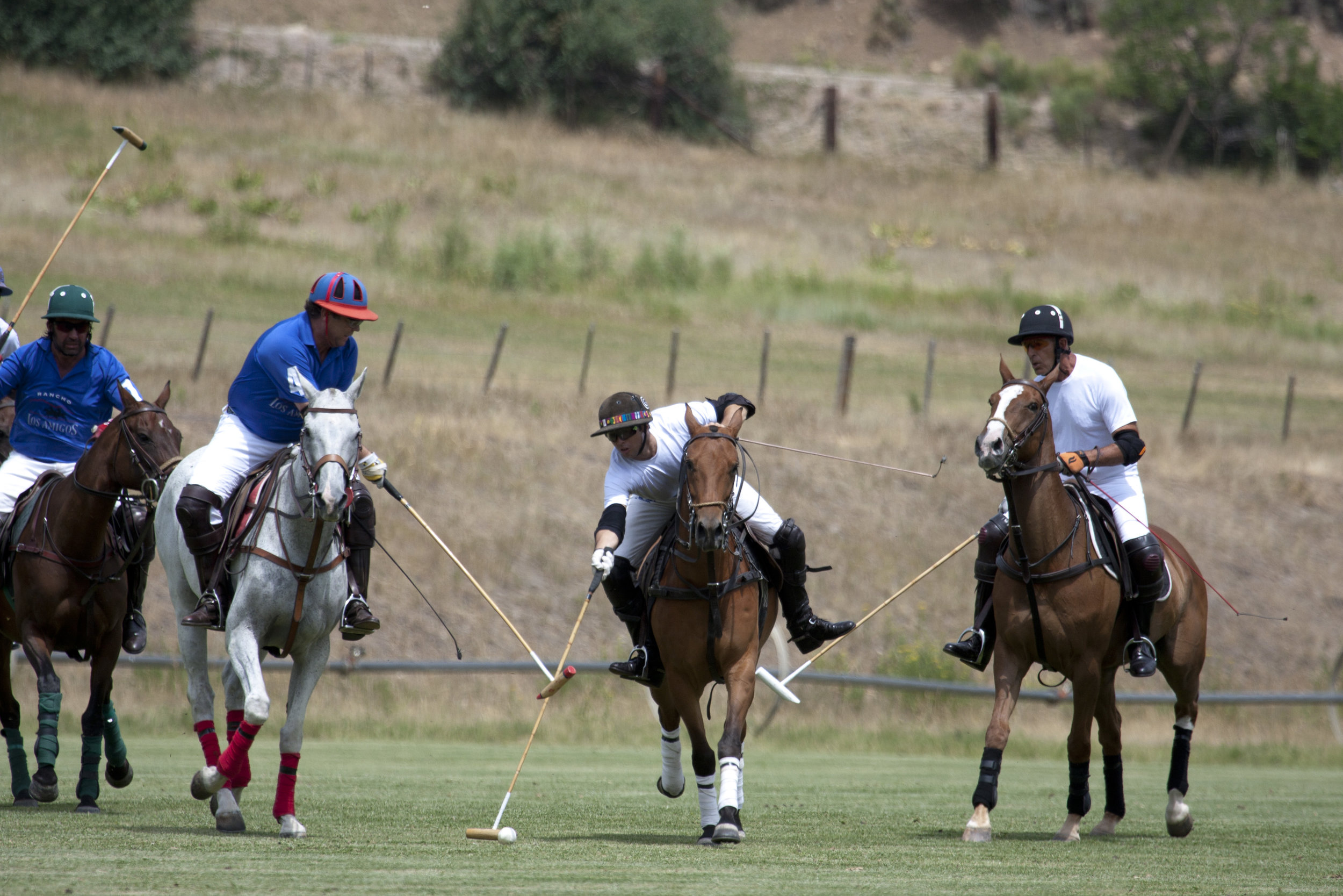 Carlitos Gracida of Piocho Ranch attempts to hit the ball a.JPG