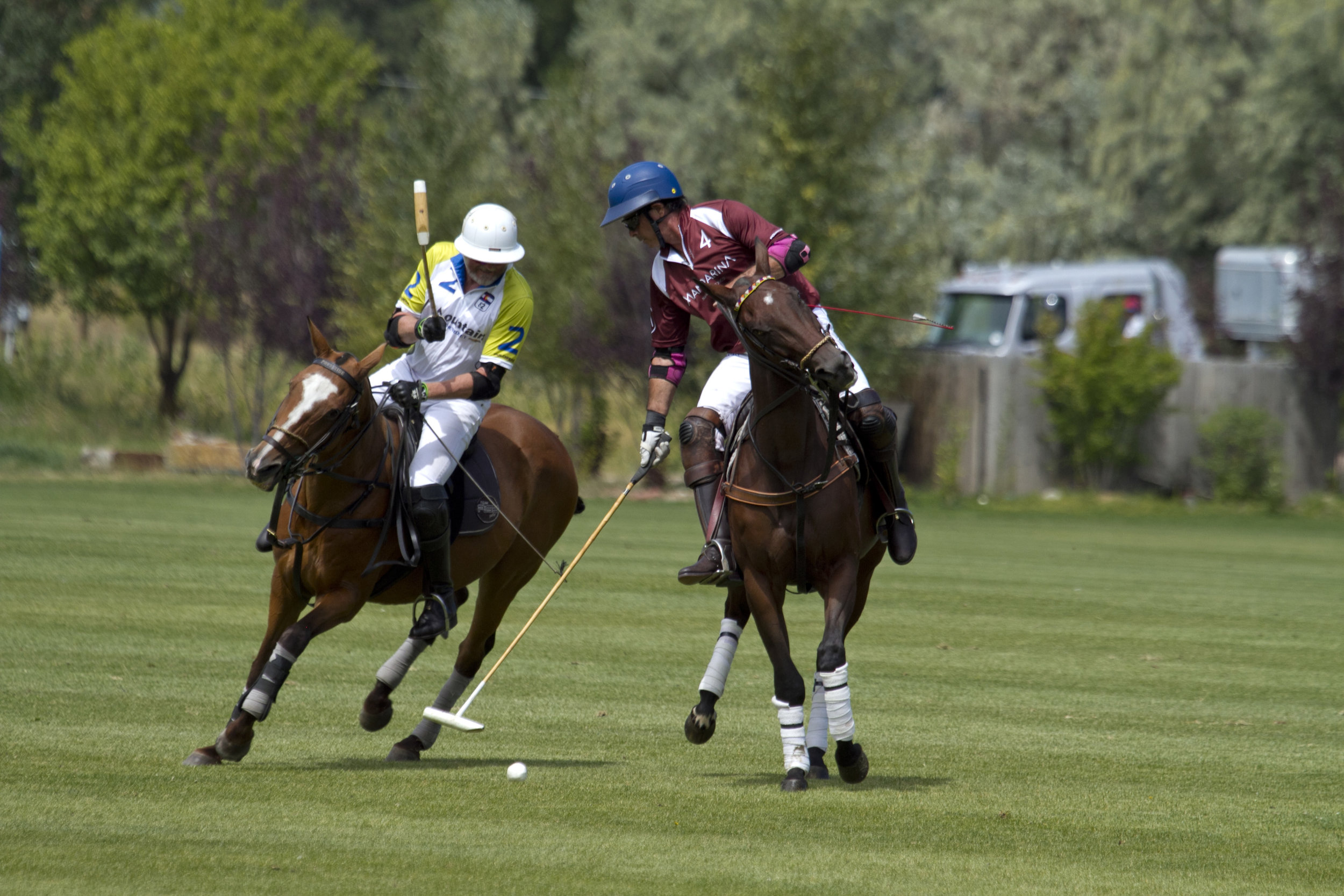 Juan Bollini of Mandarina tries to avoid defend.JPG