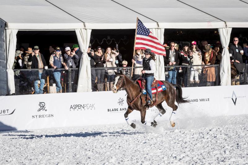 Flag bearer Hannah Hayden rides by t.jpg